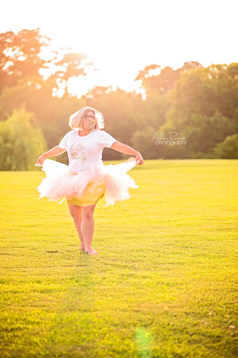 lady in tutu in field