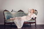 woman in lace dress on blue couch