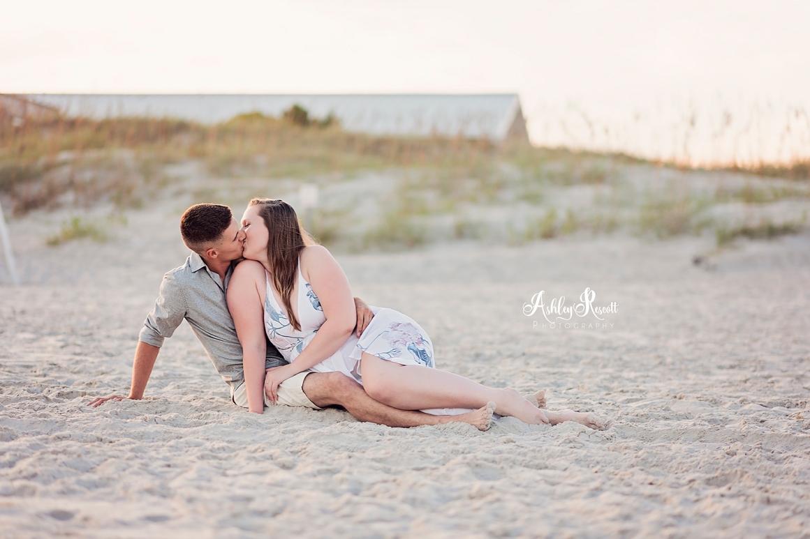 couple on beach smooching