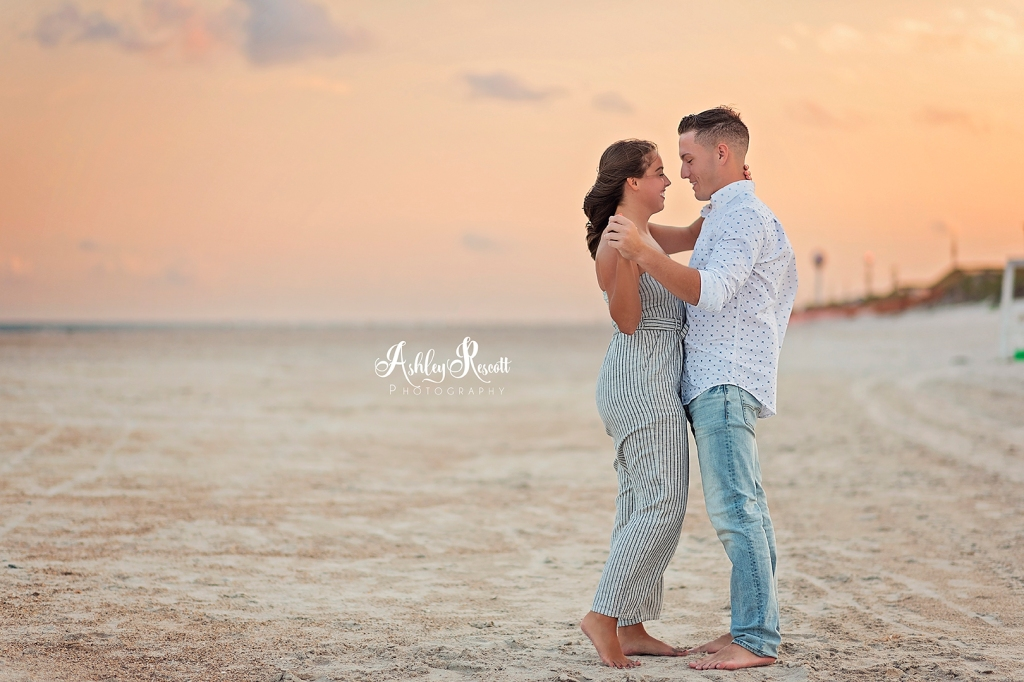 couple dancing on beach at sunset