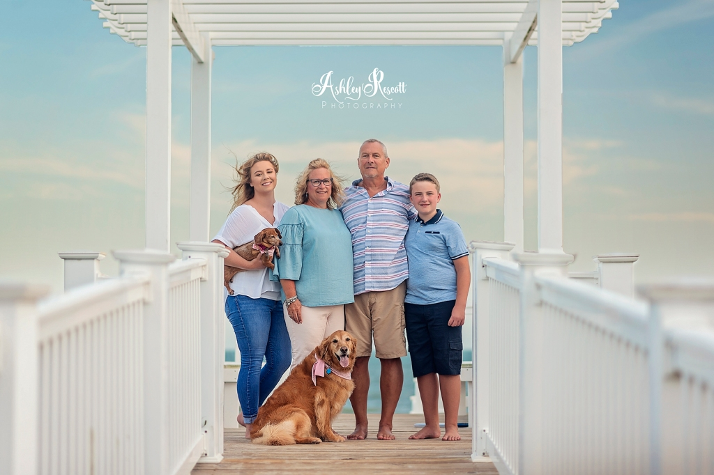 Family with dogs in pavilion