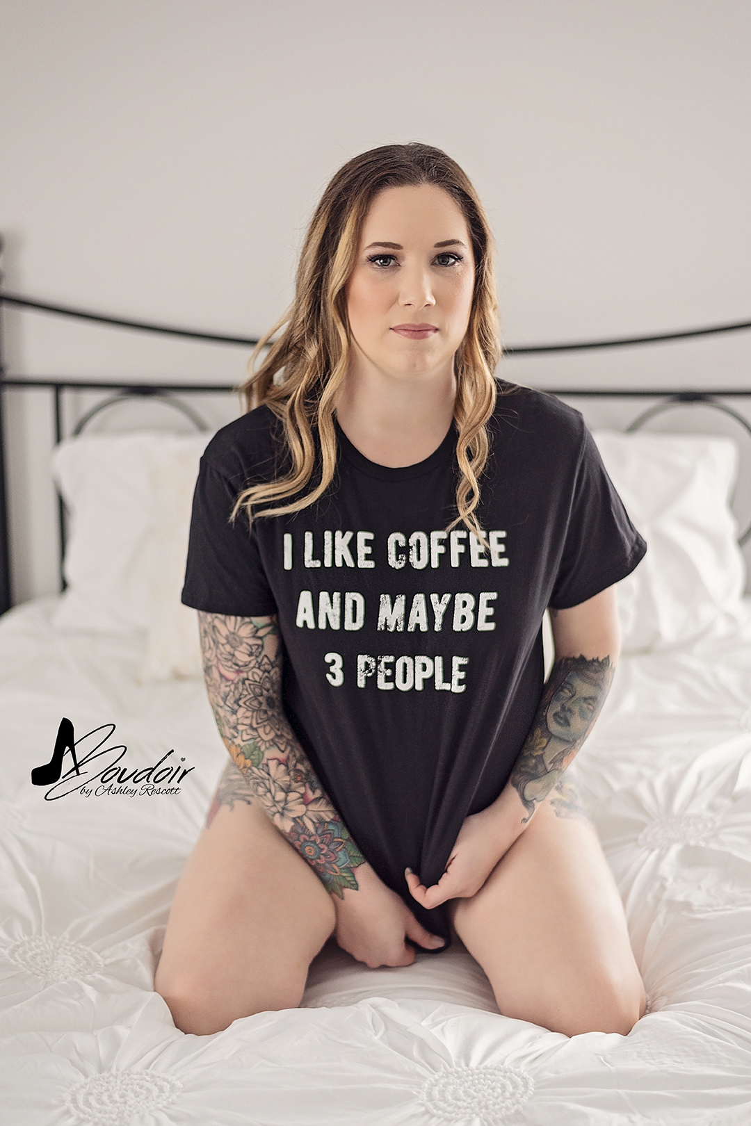 woman kneeling on bed in t shirt