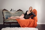 woman lounging on couch with blanket