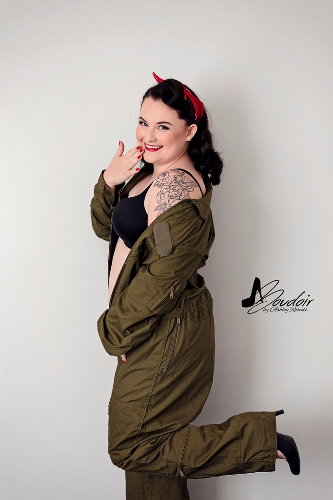 pinup image of brunette woman in military flight suit