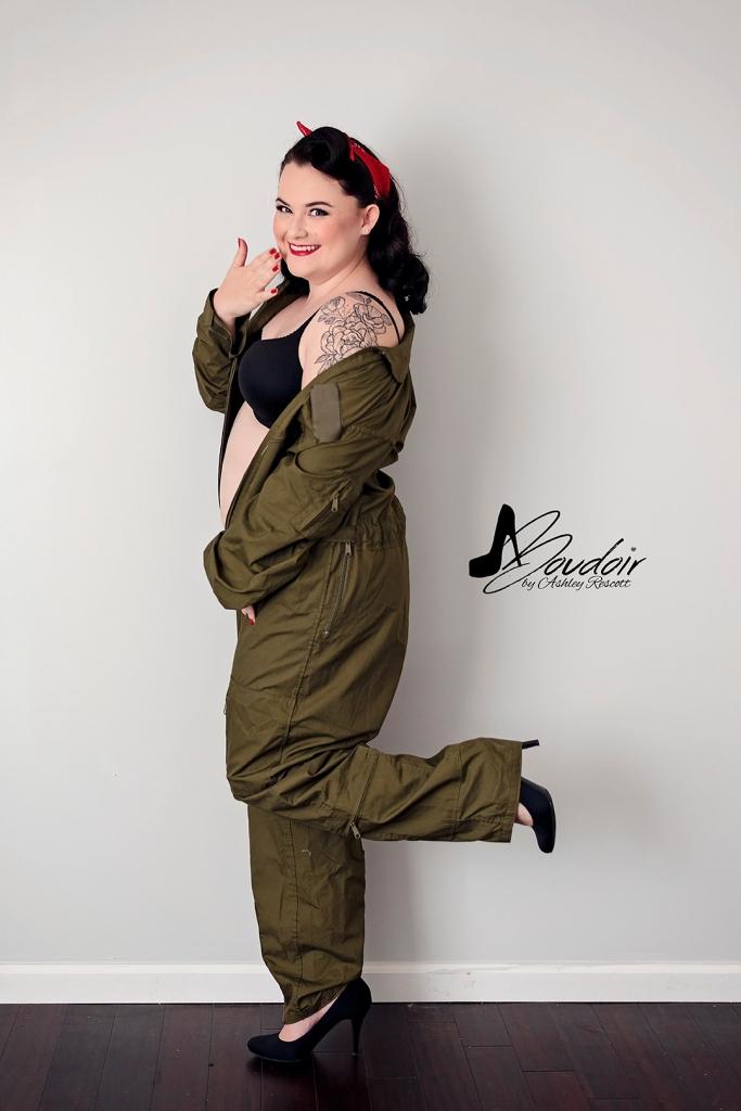 pinup in usmc flight suit and black stilettos