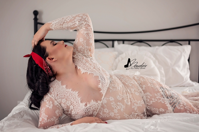 woman in white lace dress lounging in bed