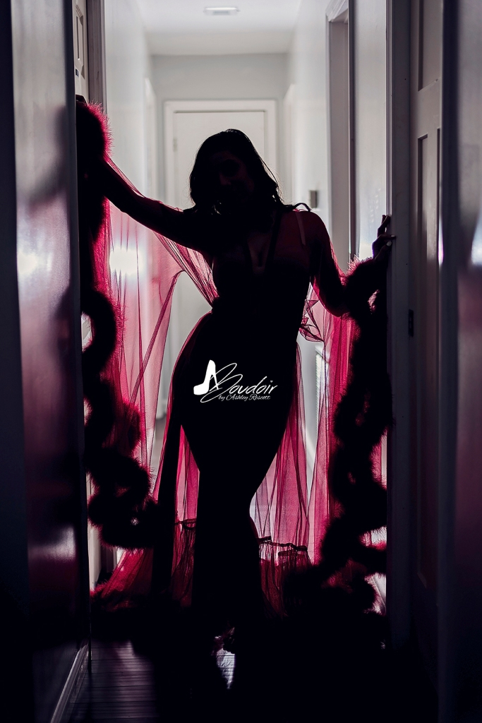 woman in red robe silhouetted in hallway