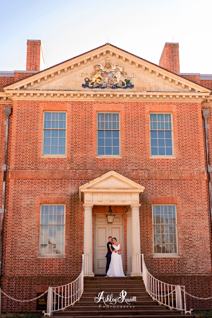 couple standing at door to palace
