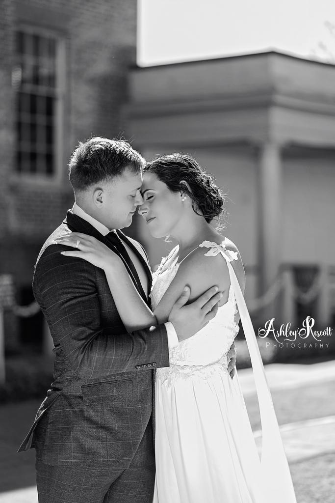 Bride & groom embracing