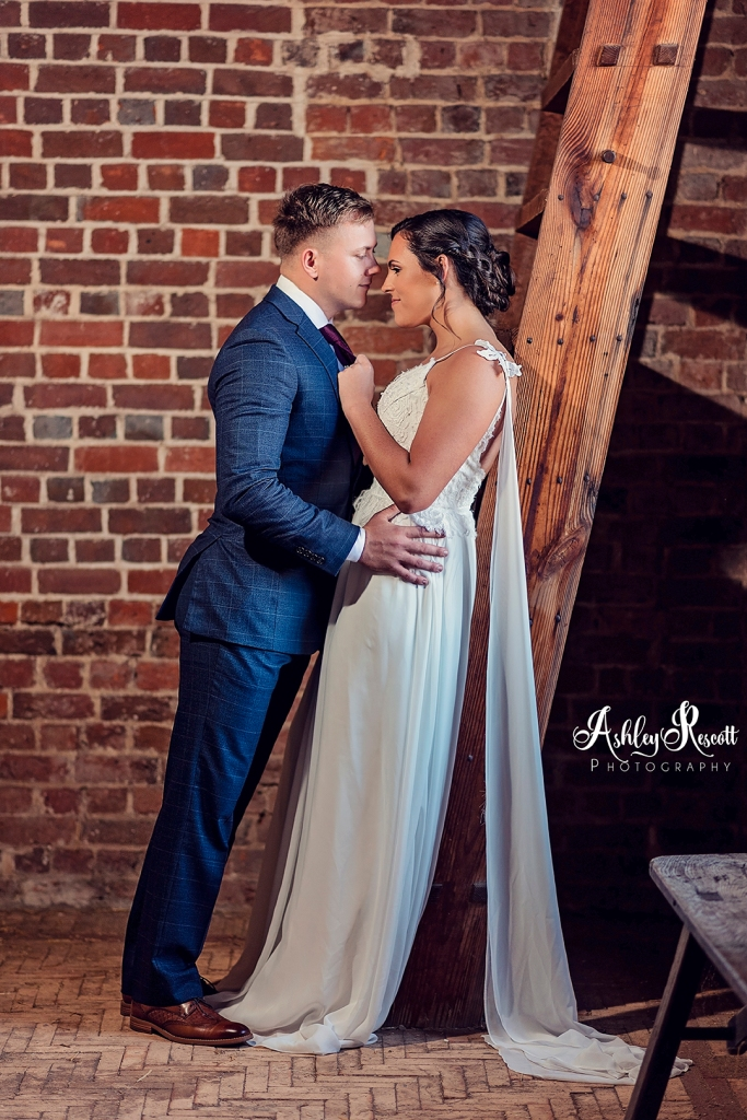 bride & groom in the stable, leaning on ladder