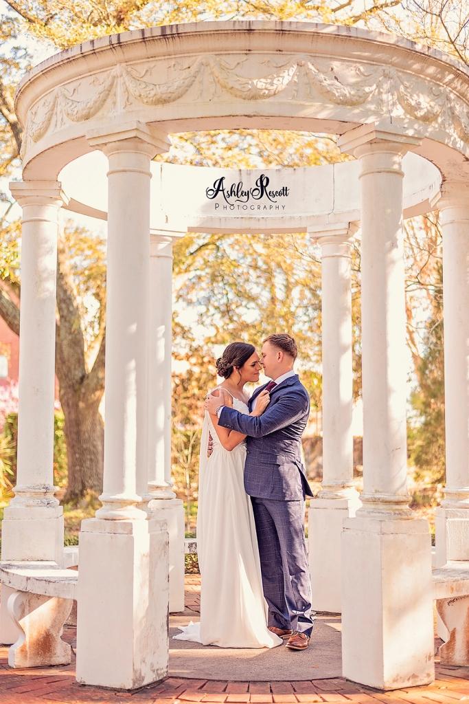 bride & groom in gazebo