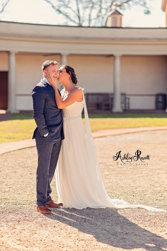 Bride kissing groom on cheek