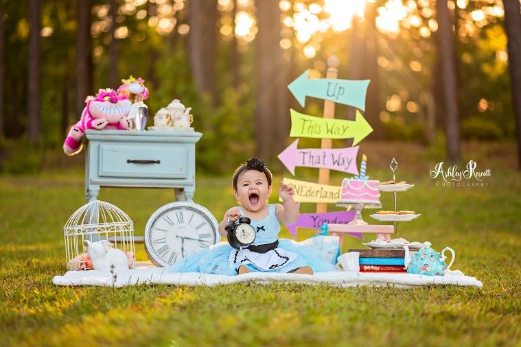 happy baby holding clock