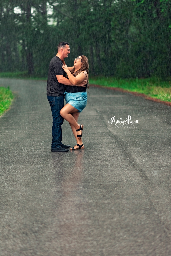 couple laughing in the rain