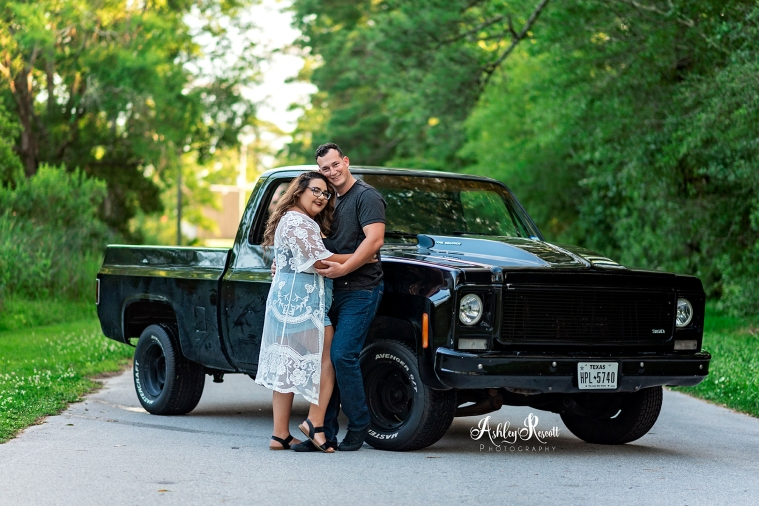 couple standing at truck