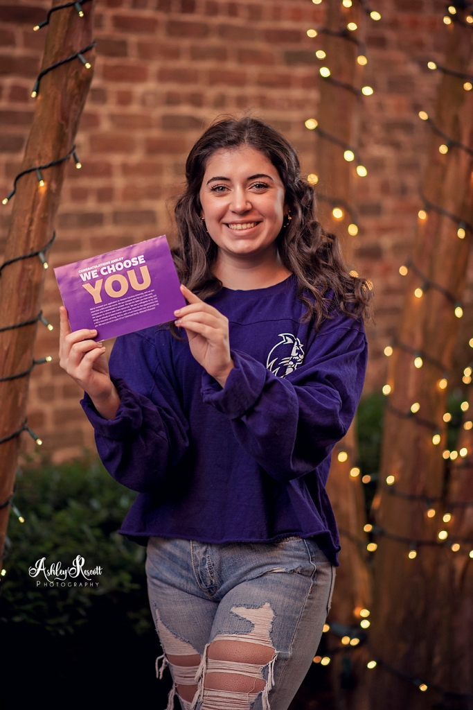 teen girl with college acceptance letter