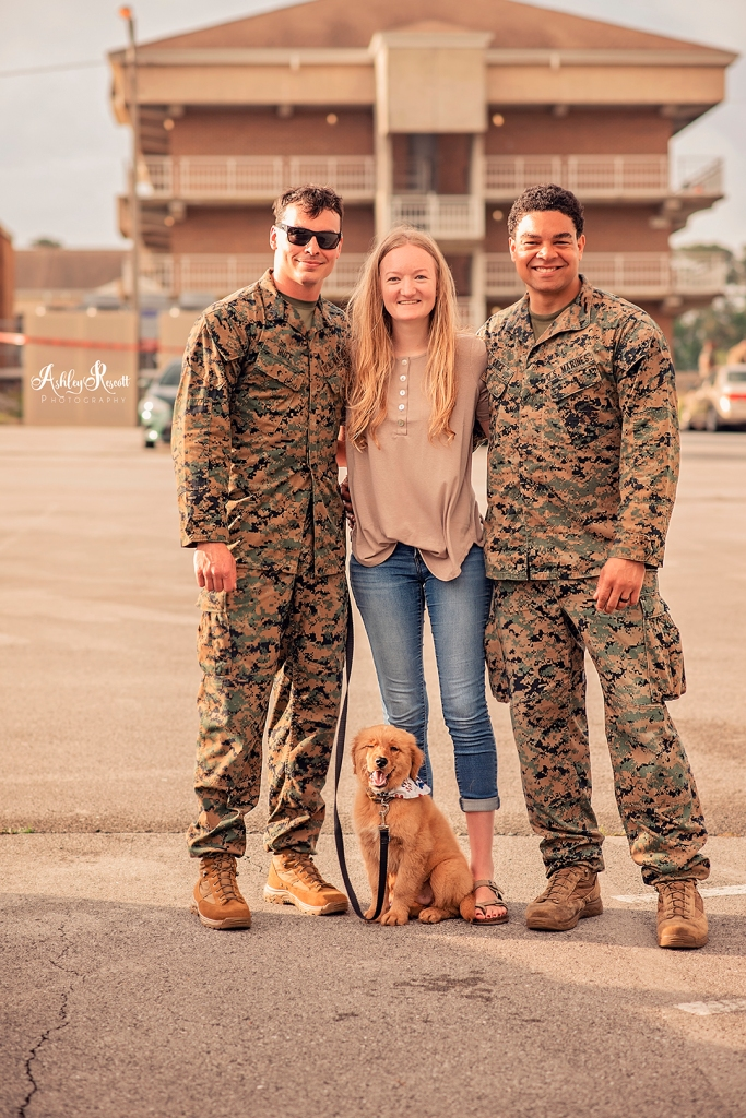 marine, battle buddy, wife pose with puppy