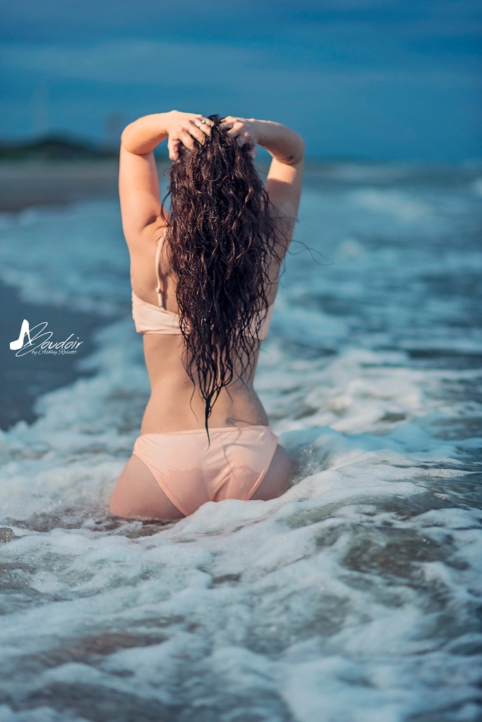 woman from behind in water