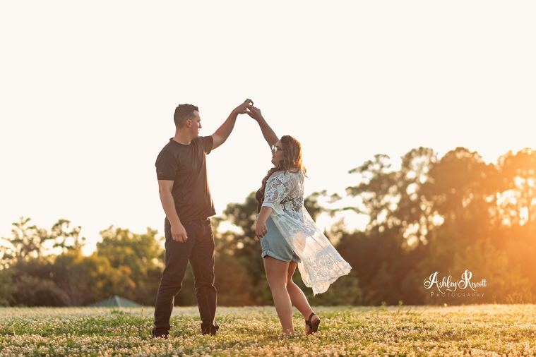 couple dancing in a field
