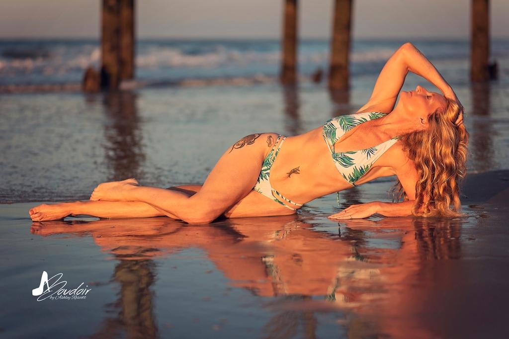 woman lying on beach at sunrise