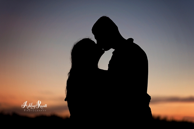 silhouette of couple kissing