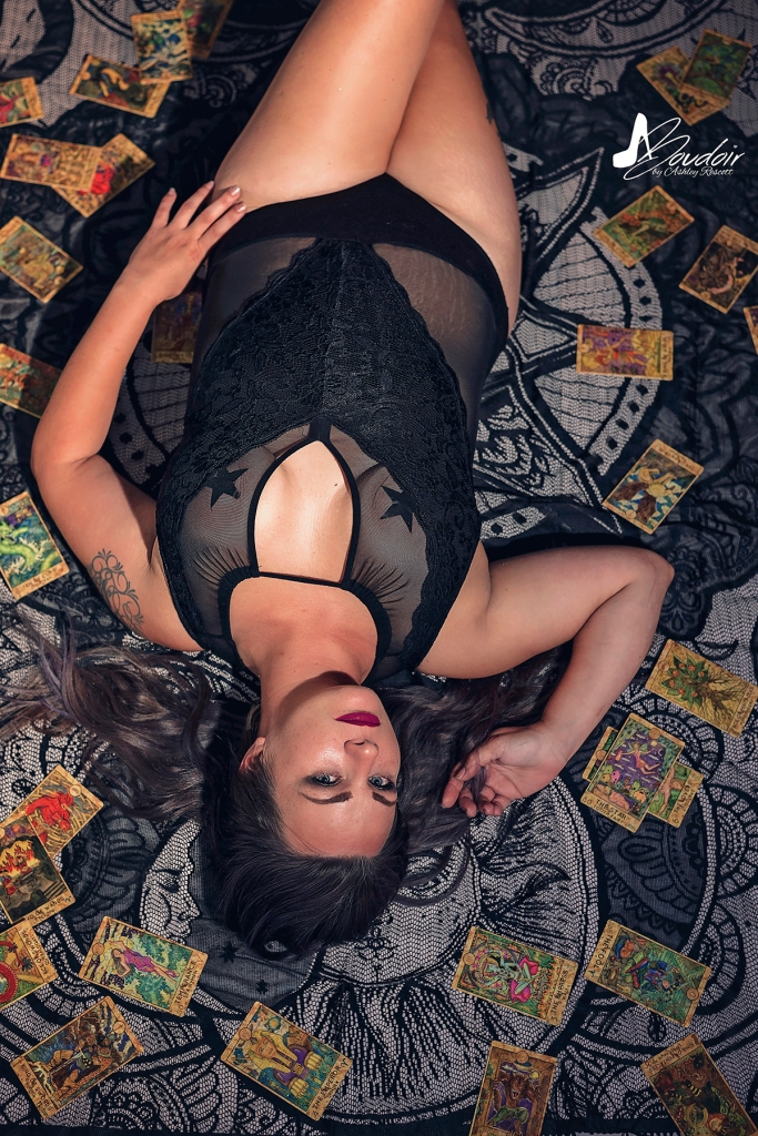 woman lying on tarot cards